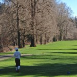 Martin follows through on shot on par 5 along Duwamish River - 21515